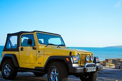 Jeep Wrangler TJ Sport 4.0L 3/4 sea (Lloyd Hobden) Tags: sea sky beach water car sport yellow lights jeep offroad 4x4 dusk convertible canvas chrome vehicle parked stationary wrangler 180550mm