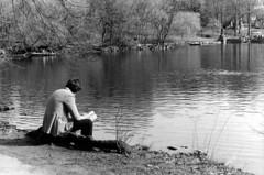 By the Pond He Reads (MeEnHaJ) Tags: ny man nature print reading blackwhite pond minolta centralpark trix iso 400 bnw x700 manandnature splitfilter