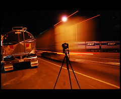 Driving by on the Hume... (heritagefutures) Tags: road longexposure nightphotography light copyright reflection night silver lights star cafe nikon highway long exposure break tripod australia melbourne tokina lorry nsw newsouthwales rest trucks tungsten hr streaks hume dirk swf position gitzo tanker allrightsreserved halfway semis nightdriving lightstreaks kenworth semitrailer nightrider westernstar lightstream nightimage longhaul humehighway tarcutta d80 spennemann positionlights nikond80 halfwaycafe photofaceoffwinner pfogold heritagefutures dirkhrspennemann copyrightdirkhrspennemann ausphoto