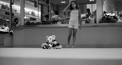 Girl with doll Faro market (Ron Isarin impressions) Tags: blackandwhite bw playing portugal girl faro doll market mercado algarve girlwithdoll ronisarin