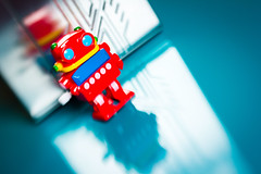 Retro Robot 2017_ColourSplash_8864_ By Phil Ovens (Pitcher_Phil) Tags: robot retro vintage colourful toy reflecions bright shiny plastic lensbaby bokeh windup mechanical