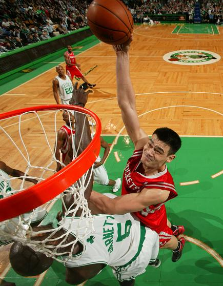 Yao Ming elevates over Boston's Kevin Garnett for a one-handed jam.  However, Garnett would get the last laugh as he willed his team to a fourth quarter victory over the surprising Rockets.
