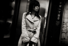 The Heart's Filthy Lessons 2 (TommyOshima) Tags: street winter blackandwhite girl monochrome japan 35mm tokyo holga shinjuku coat grainy 3200 ilford holga135bc