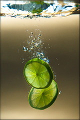 A Splash Of Lime (ylvan) Tags: summer white macro green water fruit canon wonderful gold bravo australia fresh queensland cheers citrus lime splash slices tangy 180mm nophotoshophere eow abigfave platinumphoto diamondclassphotographer willbehere theperfectphotographer canon180mmf35macro havealovelyevening mustbeareallyloooooooogmovie mondocafeclub stunningphotogpin