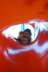 Slide (t.gruv) Tags: family school boy orange woman color slr smile up playground circle fun happy kid nikon child play hole ground slide brazilian dslr nikonian d40 nikond40