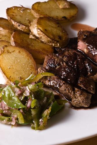 Lamb steak, red wine reduction, fried potato slices