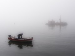 Fishing in the fog (jimiliop) Tags: sea fog mystery dark boat fishing fisherman moody atmosphere greece macedonia thessaloniki reflexions thermaikos salonika supershot mywinners abigfave goldmedalwinner ysplix theunforgettablepictures goldstaraward landscapesdreams