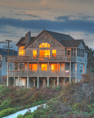 House on Fire (avirus) Tags: red house reflection beach sunrise fire shiny northcarolina outerbanks obx