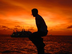 sunset (fayaaz) Tags: light sunset sea sky beautiful yellow boat seaside asia wave pic maldives coluds firesunset nicecolours hulhumale saarc fayaazphoto