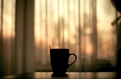 Good evening world (Fa.bian) Tags: sunset red cup evening glow sundown bokeh curtain spoon dreaming inmyroom canonef50mmf14usm canoneos30d bildermacher fabiangehweiler
