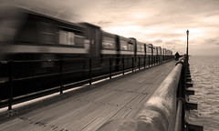 Southend : Pier Scene 1 (Peter&JaneBurns) Tags: seascape lamp sepia train canon pier blackwhite tram motionblur essex southend eastanglia thamesestuary abigfave platinumphoto ultimateshot diamondclassphotographer goldstaraward