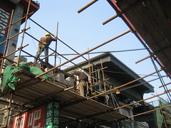 busy busy (kattebelletje) Tags: scaffolding beijing qianmen reconstruction manontheroof repairwork  china2008