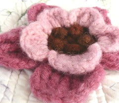 pink and brown crochet flower