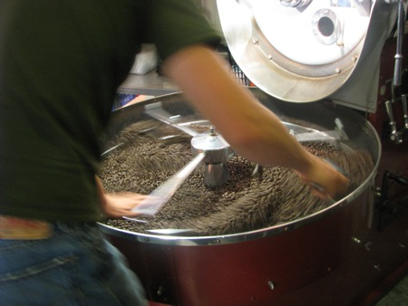 Stirring up the roasted coffee beans