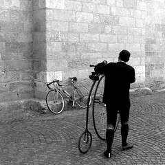 time machine (overthemoon) Tags: explore interestingness 147 france moissac man bw bicycle pennyfarthing midipyrénées spring square stones cobbles grandbi hochrad tarnetgaronne surreal bestofr redmatrix caraire deniscaraire gettyimages bsquare