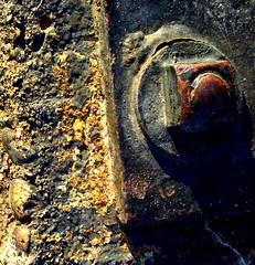 bolted down (hobit&gollum) Tags: metal sand rust iron stones nutbolt
