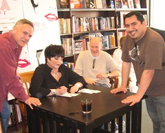 Liza signs James' DVD as Craig Zadan & Neil Meron look on. (05/06/2006)