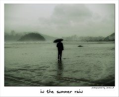 Lost (Jordan_K) Tags: city brazil black praia beach beautiful rain umbrella lost solitude waves artistic walk bodylanguage jordan santos melancholy backsight