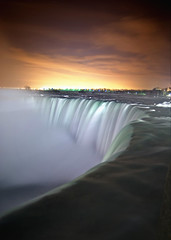 Niagara Falls by Night (Insight Imaging: John A Ryan Photography) Tags: longexposure orange toronto ontario canada motion colour water night flow photography niagarafalls yahoo google lowlight flickr shot niagara falls aficionados 30second magicdonkey abigfave niagarafallsatnight pentaxk10d diamondclassphotographer flickrdiamond frhwofavs theunforgettablepictures justpentax goldstaraward goldenvisions wwwinsightimagingca johnaryanphotography tgamphotodeskcolour hpcwater