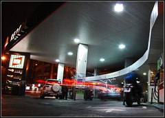 Gas station 3 (Aldo Trim) Tags: madrid longexposure light car night ceiling gasstation arrow curve mortorcycle nikond40x thatsclassy