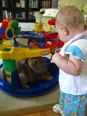 Jasper playing in Clara Ann's exersaucer