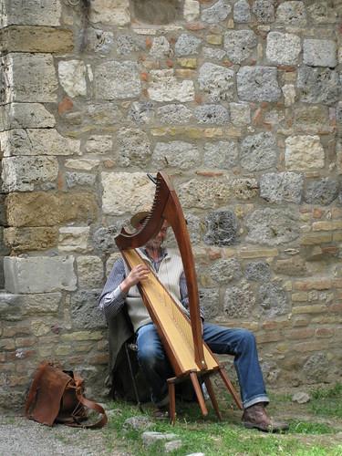 Man playing harp in San Gimignano, Italy