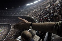 Nou Camp gesture  Rob Watkins 2005 (Aland Rob) Tags: barcelona 2005 camp people panorama football spain barca sitting hand arm terrace stadium soccer crowd catalonia sit crown catalunya cheer win gesture fc seated winners cf league nou champions catalan debate cataluna culs culers photographrobwatkins