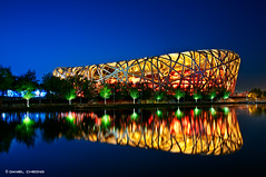 Bird's Nest Golden Blue (DanielKHC) Tags: china blue bird water architecture night digital reflections nikon long exposure nest stadium beijing hour 北京 olympic 中国 dri blending d300 鸟巢 tamron1750mmf28 danielcheong danielkhc