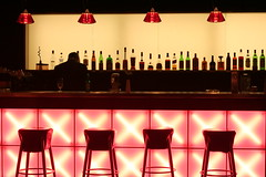 Need a Drink? (romaniashots) Tags: bar hotel bottles romania xs bartender sibiu interestingness205 i500 mywinners romaniashots