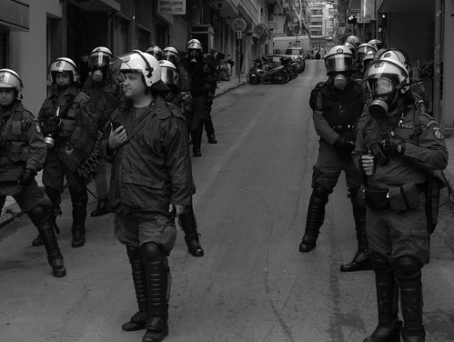 Greek riot police on standby during protest march - Thessaloniki, Greece.