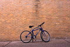 blue bike (xgray) Tags: blue brick bike bicycle wall digital upload 35mm canon austin eos prime university texas bricks universityoftexas iphoto 40 bikerack ef35mmf2 40d jestercenter