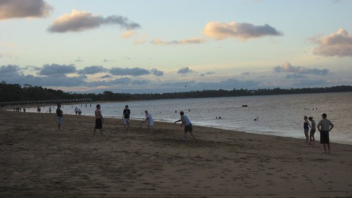 Beach cricket at sunset