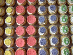 Box of Baby Shower Cupcakes (clevercupcakes) Tags: baby footprints outfits babyshower bibs carriages montrealsclevercupcakes