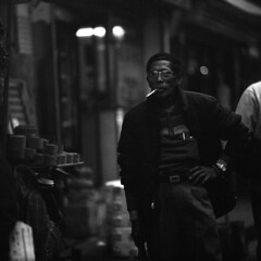 skeptical (memetic) Tags: street bw man 120 6x6 mediumformat asian hongkong blackwhite village tl cigarette watching chinese stranger hp5 ilford newterritories p6 taio pentaconsix sonnar 180mm