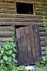 Slipping Away (Kim.Deslandes) Tags: wood window loft barn decay logs oldwood barndoor weathering loftwindow canon40d