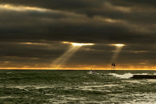 Sunlight breaks through the clouds just off of Scituate Harbor.