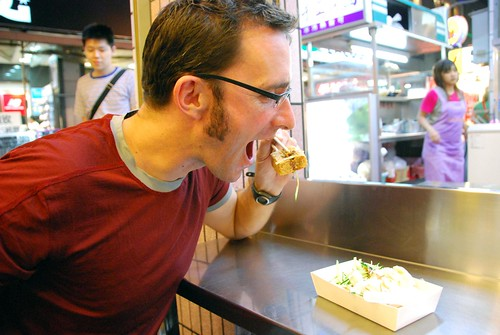 jeremy eating stinky tofu, taichung night market