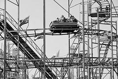 Coasting (DevilFishMark) Tags: blackandwhite car blackwhite ride flag flags rollercoaster coaster funfair southport 2011 a700 coasting