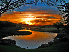 Magic (oybay©) Tags: blue autumn trees sunset arizona orange mountains reflection fall nature water yellow clouds mirror pond contrail desert natural cloudy branches vivid framing streaks brucespringsteen springsteen naturesfinest vistancia specnature abigfave megashot