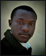 the teacher (kathalijne) Tags: travel portrait man color wall digital southafrica hurt capetown cracks past sonycybershot uncertainty sodade kathalijnevanzutphen athousandstories viachicagobywilco