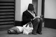 Just Reading (leafpeeker) Tags: london hat strand vent reading glasses pavement tesco jeans sleepingrough