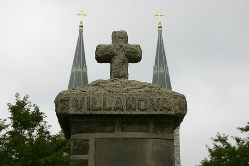 St. Thomas of Villanova Church from behind a stone column