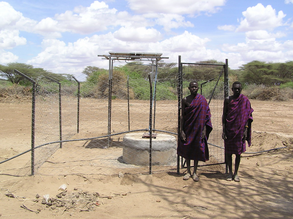 Turkana men with solar powered pump station