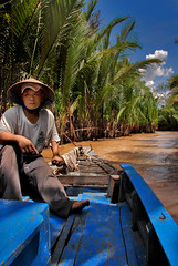 Boatman (fesign) Tags: blue river boat dragon mekongdelta waterman boatman mekongriver sculler oarsmen nativepeople fesign delta istvankadar colorphotoaward nine sngculong