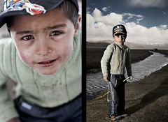 Boy at the Marshes (Jeremy Snell) Tags: china boy red portrait water face clouds river 50mm eyes stream sad emotion expression xinjiang emotional f18 marshes tashkorgan