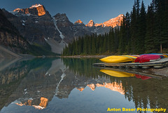 Moraine Lake Sunrise with Canoes, Banff NP, Canada (.Anton) Tags: lake snow mountains colour reflection sunrise 500v20f glacier canoes banff breathtaking morainelake valleyofthetenpeaks banffnp flickrdiamond