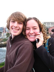 Conversation on Hold (ps.iloveyou) Tags: ocean boy people girl buildings happy smiles cellphone lajolla curlyhair brownsweater krazr
