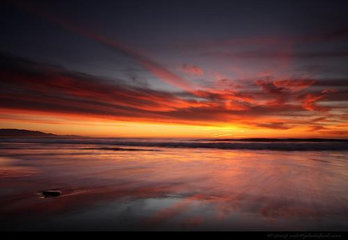 seascape beach twilight sunset cloud sand reflection stone rock surf santabarbara california photofool