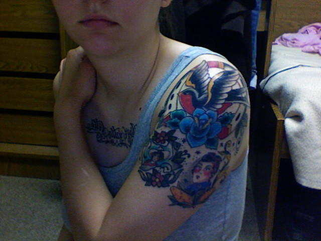 Tattoo III. Blue flower/ sparrow/ horseshoe.. Flower is a cover-up of a