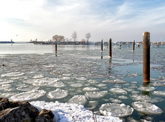 Frosty Harbor (HJharland5) Tags: icy frozen water lake lakeerie cleveland ohio harbor breakwall snow seagull post sky winter cold